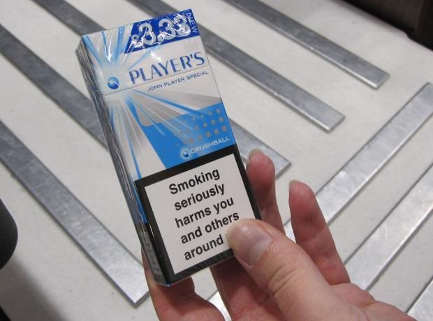 cigarettes banned A ban on 10-packs of cigarettes will begin under a strict new law enforced from tomorrow new packaging laws are also coming into place, which will mean all cigarette boxes will look similar all packets will have to be the same olive green colour, with the same font, size, case and text appearance.